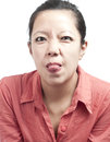 Tongue sticking out woman the Royalty Free Stock Photos