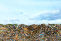 Tons of plastic waste on sky background blue Royalty Free Stock Photography