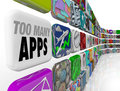 Too many apps software programs oversupply glut surplus the words on a tile in a wall full of application icons illustrating an or Royalty Free Stock Photos