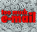 Too much email symbol sign symbol background mail the words e on a of at or symbols and signs to illustrate being flooded with Stock Photos