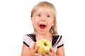 Toodler girl eating an apple isolated over white Royalty Free Stock Photography