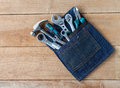 Tool belt with tools on wooden board background Royalty Free Stock Photo