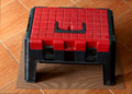 Tool box red on plywood in the garage Royalty Free Stock Images