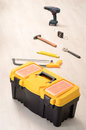 Tool box yellow and work tools on wooden floor in empty room Stock Images