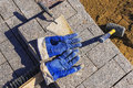 Tool for laying paving slabs on a background of granite bricks a Royalty Free Stock Photo