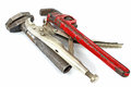 Tools adjustable spanner pincers and pipe wrench isolated in white Stock Photos