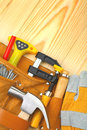 Tools in belt on wooden boards Royalty Free Stock Images