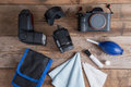 Tools for cleaning camera with dslr camera and lens, flash.