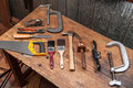 Tools a few essential timber saw g clamp no plane wrench set pliers paint brushes and a hammer Stock Photos