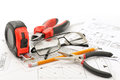 Tools and glasses on the drawing Stock Photos