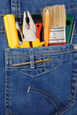 Tools and instruments in blue jeans Stock Images