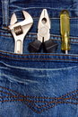 Tools and jeans Stock Images