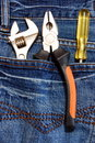 Tools and jeans Stock Photography