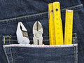 Tools and jeans pocket Royalty Free Stock Images