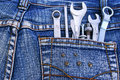 Tools in jeans pocket Royalty Free Stock Photos