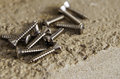 Tools a number of screws scattered arround ready to be used Stock Photos