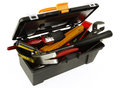 Tools in open toolbox on plain background Royalty Free Stock Photography