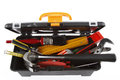 Tools in open toolbox on plain background Royalty Free Stock Image