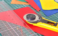 Tools for patchwork: knife, ruler and cutting out the mat Royalty Free Stock Photo