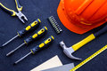 Tools for repairing on black stone desk background top view copyspace