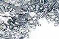 Tools wrenches nuts and bolts on plain background Stock Photo