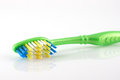 Tooth-brush with green handle Stock Photography