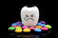 Tooth decay is crying with emotions sugar coated Royalty Free Stock Photo