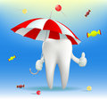 Tooth holding an umbrella Royalty Free Stock Photo