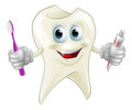 Tooth man holding paste and brush an illustration of a cartoon character mascot a toothbrush tube of toothpaste Stock Photos