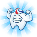 Tooth mascot muscle man dental cartoon character a powerful molar with paste for hair flexing his muscles Stock Photo