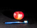 Toothbrush and apple Stock Photos