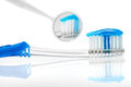 Toothbrush blue and mirror Royalty Free Stock Photo