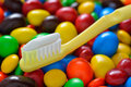 Toothbrush candy background Stock Photos