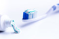 Toothbrush isolated on a white background with reflection and toothpaste. Blue plastic toothbrush. Concept of dental medicine. Royalty Free Stock Photo