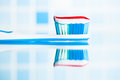 Toothbrush with red stripe toothpaste and mirror reflection Royalty Free Stock Photo