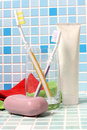 Toothbrush and soap on a tile in bathroom Stock Images