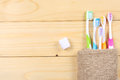 Toothbrush tooth-brush with bath towel on wooden table. top view with copy space Royalty Free Stock Photo