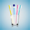 Toothbrush, toothpaste in a glass Royalty Free Stock Photo