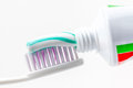 Toothbrush and toothpaste an with with green white colors Stock Photography