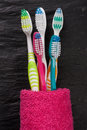 Toothbrushes on the black stone background Royalty Free Stock Photo