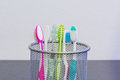 Toothbrushes with colourful palce in the metal basket Royalty Free Stock Photography