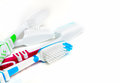 Toothbrushes lying on white background Stock Photography