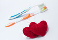 Toothbrushes and Red hearts Royalty Free Stock Photography