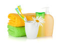 Toothbrushes, shampoo, towels and flower Stock Photos