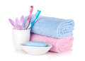Toothbrushes, soap and two towels Royalty Free Stock Photos
