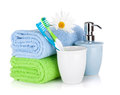 Toothbrushes, soap and two towels Stock Photos