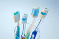 Toothbrushes to clean teeth several in a cup waiting for the cleaning Stock Image