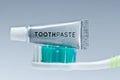 Toothpaste mini tube on toothbrush Royalty Free Stock Photo