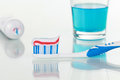 Toothpaste on a toothbrush and rinse for mouth in a bathroom Royalty Free Stock Image