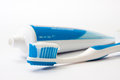 Toothpaste on a toothbrush with a tube Royalty Free Stock Photo